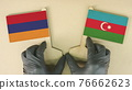 Flags of Armenia and Azerbaijan made of recycled paper on the cardboard table 76662623