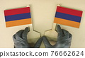 Flags of Armenia made of recycled paper on the cardboard table 76662624