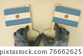 Two flags of Argentina made of recycled paper on the cardboard table 76662625