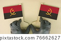 Flags of Angola made of recycled paper on the cardboard table 76662627