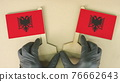 Two flags of Albania made of recycled paper on the cardboard table 76662643