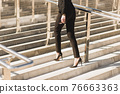 Closeup woman have pain in leg because wearing highheels. Conception about carrer and business 76663363