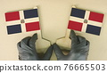 Flags of Dominican Republic made of recycled paper on the cardboard table 76665503