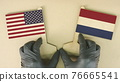 Flags of the USA and Netherlands made of recycled paper on the cardboard table 76665541