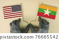 Flags of the USA and Myanmar made of recycled paper on the cardboard table 76665542