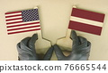 Flags of the USA and Latvia made of recycled paper on the cardboard table 76665544