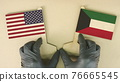 Flags of the USA and Kuwait made of cardboard on the desk 76665545
