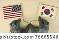 Flags of the USA and Korea made of recycled paper on the cardboard table 76665548