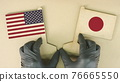 Flags of the USA and Japan made of recycled paper on the cardboard table 76665550