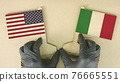 Flags of the USA and Italy made of cardboard on the desk 76665551