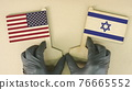 Flags of the USA and Israel made of recycled paper on the cardboard table, top-down view 76665552