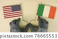 Flags of the USA and Ireland made of recycled paper on the cardboard table, top-down view 76665553