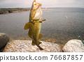 cod on fishing-rod on background of sea 76687857