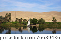 Egypt Nile river side view felucca boat and telephone signal tower 76689436