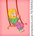 Happy muslim girl sit on swing 76700492