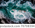 Storm waves of the sea around the ship. 76708394