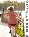 girl on bike 76715656