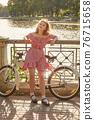 girl with bike 76715658