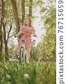 girl on bike 76715659