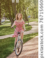 girl on bike 76715660