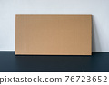 Cardboard card on the table by the wall 76723652