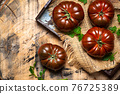 Primora tomato on a rustic wooden table 76725389