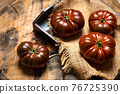Primora tomato on a rustic wooden table 76725390