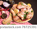 Raw chicken drumsticks with cooking ingredients 76725391