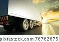 Rear angle view of delivery truck run on the road 76762675