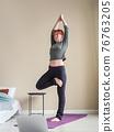 Red hair woman practicing yoga asanas. Yoga 76763205