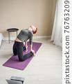 Young woman bent back performing yoga poses. Yoga 76763209