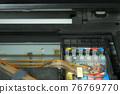 Continuous ink supply system is working in printer moving inside, closeup view. 76769770