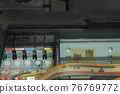 Continuous ink supply system is working in printer moving inside, closeup view. 76769772