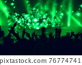 Crowd at a music concert, audience raising hands up 76774741