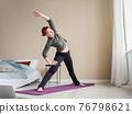 Girl coach doing stretching exercises on yoga mat 76798621