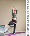 Young woman doing yoga. Yoga exercise online at 76798622