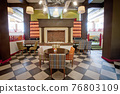 Colorful stylish interior of restaurant with fireplace 76803109