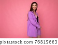 Shot of young positive happy attractive brunette woman wearing stylish violet suit isolated on pink 76815663