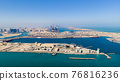 Aerial view of Abu Dhabi skyline rising over the seaside forming modern waterfront of the UAE capital 76816236