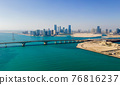 Aerial view of Abu Dhabi skyline rising over the seaside forming modern waterfront of the UAE capital 76816237