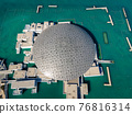 Louvre museum in Abu Dhabi emirate of the United Arab Emirates at sunrise aerial drone view of the building appear to float on the seaside 76816314
