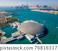 Louvre museum in Abu Dhabi emirate of the United Arab Emirates at sunrise aerial drone view of the building appear to float on the seaside 76816317