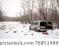 Mitsubishi Pajero/Montero in winter forest with firewood in the trunk 76851489