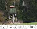 Wooden lookout tower for hunting in the woods and on meadow 76871818
