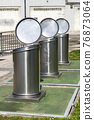 Open trash containers close-up. Stationary street metal sorting empty bins. Saving ecology concept 76873064