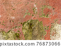 Mottled textured painted peeling cement old wall with stains of peeled paint. Abstract vintage background 76873066