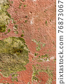 Destroyed painted cement plastered wall. Weathered corrosive surface. Abstract background. Red and yellow. Vertical view 76873067