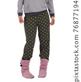 girl in pajamas gray jacket, pants with green circles and ugg boots on her legs. White background 76877194