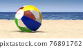 A beach ball on a beach 76891762