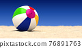 A beach ball on a beach 76891763